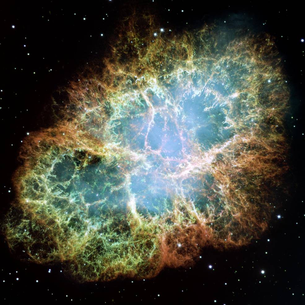 The best-known wind nebula is the Crab Nebula, located about 6,500 light-years away in the constellation Taurus. At the center is a rapidly spinning neutron star that accelerates charged particles like electrons to nearly the speed of light. As they whirl around magnetic field lines, the particles emit a bluish glow. This image is a composite of Hubble observations taken in late 1999 and early 2000. The Crab Nebula spans about 11 light-years. Credits: NASA, ESA, J. Hester and A. Loll (Arizona State University)