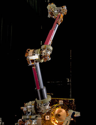 An engineering design unit of the NASA Servicing Arm, which will be used for the Restore-L mission, stands in the Robotics Operations Center at NASA's Goddard Space Flight Center. Credits: NASA/Chris Gunn
