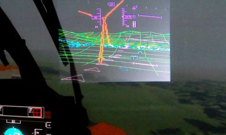 View from the inside of the helmet: green lines represent mountains and houses, while the red outline depicts wind turbines, construction cranes and high buildings. Image credit: Technical University of Munich.