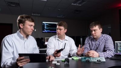 GTRI researchers (l-r) Heyward Adams, Andrew Hardin and Greg Bishop examine Internet of Things devices whose output can be integrated using GTRI's new FUSE software. Image credit: Rob Felt, Georgia Tech