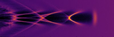 """A laser pulse scything through a plasma and trailed by a """"bubble"""" (region of low electron density) credit Strathclyde University"""