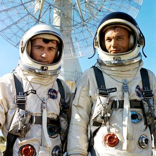 Gemini X command pilot John Young, left, and pilot, Mikel Collins, pause on July 16, 1966, during training at Cape Kennedy (now Cape Canaveral) Air Force Station in Florida. Credits: NASA