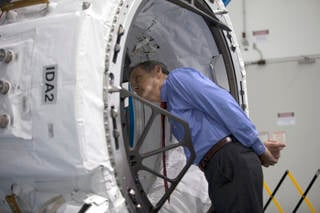 Former astronaut Bob Cabana, director of NASA's Kennedy Space Center in Florida, surveys the IDA-2 inside the Space Station Processing Facility. Credits: NASA