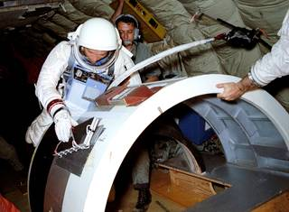 A month prior to the launch of Gemini X, astronaut Mike Collins practices retrieving a micrometeorite experiment from the Agena spacecraft used during the Gemini VIII mission in March 1966. The training took place aboard a U.S. Air Force KC-135 aircraft. The jet flew parabolic curves to create a few moments of zero-gravity. Credits: NASA