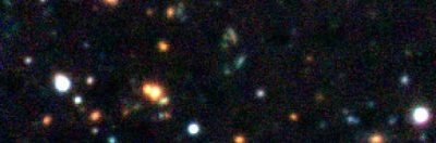 A very distant galaxy cluster in the early Universe. Image credit: ESO