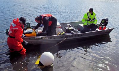 U. S. Geological Survey Scientists Carol Johnson, Eric White and Tim McCobb prepare to deploy geophysical equipment in a coastal embayment April 9, 2015 in Falmouth, Massachusetts. This equipment will outline the geological conditions under the water, which will give the scientists a better understanding of the geology and hydrology of the sandy glacial deposits underlying this portion of Cape Cod's coast.
