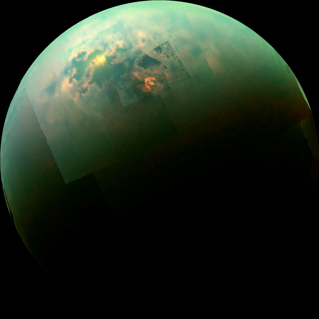 Sunlight glints off of Titan's northern seas this near-infrared, color mosaic from NASA's Cassini spacecraft. Credits: NASA/JPL/Univ. Arizona/Univ. Idaho