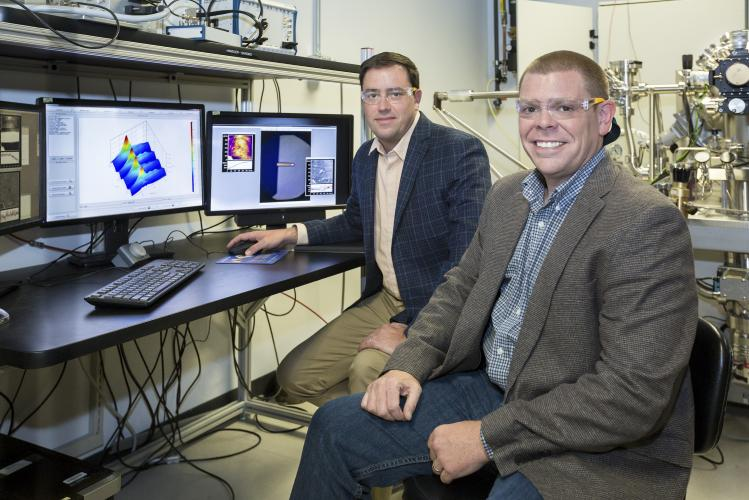 ORNL software engineer Eric Lingerfelt (right) and Stephen Jesse (left) of ORNL's Center for Nanophase Materials Sciences led the development of the Bellerophon Environment for Analysis of Materials (BEAM), an ORNL platform that combines the lab's state-of-the art imaging technologies with advanced data analytics and high-performance computing to accelerate materials science research