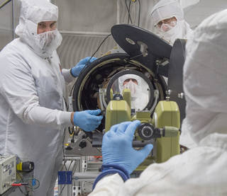 Patrick Champey (University of Alabama – Huntsville graduate student), Richard Gates and William Podgorski (Smithsonian Astrophysical Observatory) complete an alignment procedure on the Hi-C instrument in a clean room at the National Space Science Technology Center in Huntsville, Alabama, prior to shipping to White Sands Missile Range in New Mexico for its July 19, 2016, launch. Credits: NASA/MSFC/Emmett Given