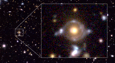 The inner arc of the Eye of Horus has a reddish hue, while the outer arc has a blue tint. The yellowish object at the center is a massive galaxy that bends the light from the two background galaxies. Image: National Astronomical Observatory of Japan