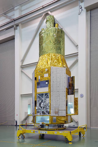 The Hitomi spacecraft, then known as ASTRO-H, as it appeared on Nov. 27, 2015, at Tsukuba Space Center in Japan. The open compartment visible at the spacecraft's lower left houses the Soft X-ray Spectrometer. Credits: JAXA