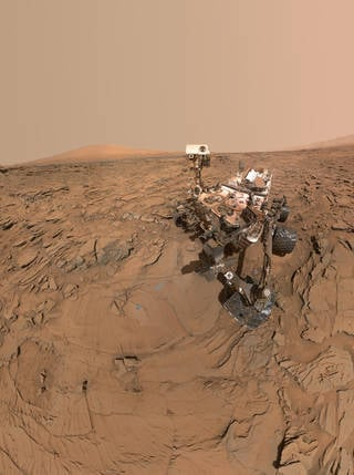 """This May 11, 2016, self-portrait of NASA's Curiosity Mars rover shows the vehicle at the """"Okoruso"""" drilling site on lower Mount Sharp's """"Naukluft Plateau."""" The scene is a mosaic of multiple images taken with the arm-mounted Mars Hands Lens Imager (MAHLI). Credits: NASA/JPL-Caltech/MSSS"""