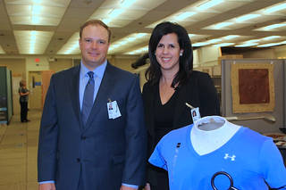 Susan Bernard, owner of Textile Technologies, and Robert Donley, the chief technology officer, in a lab at NASA Langley with a t-shirt containing the SansEC sensors they are licensing.