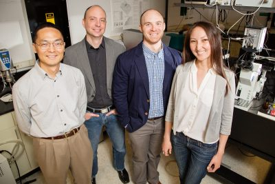 Illinois researchers found that one class of gene-editing proteins searches for its target by sliding along DNA like a zipline. Pictured, from left: professor Huimin Zhao, professor Charles Schroeder, graduate students Luke Cuculis and Zhanar Abil. Photo by L. Brian Stauffer
