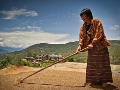 A woman tends a garden in Bhutan, a nation in which seven of 10 families depend on agriculture. Image credit: Asian Development Bank