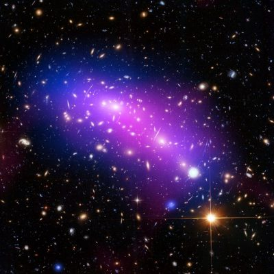 Massive galaxy cluster MACS J0416 seen in X-rays (blue), visible light (red, green, and blue), and radio light (pink). Image credit: NASA/CXC/SAO/G.OGREAN/STSCI/NRAO/AUI/NSF.