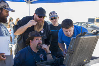 nathan Adams, from left, John Bodylski, Justin Hall, Caitlin Kennedy and Dave Berger watch a computer screen providing the Prandtl-M's exact location and altitude. Credits: NASA Photo / Kyria Luxon