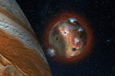 "Artist's concept of the atmospheric collapse of Jupiter's volcanic moon Io, which is eclipsed by Jupiter for two hours of each day (1.7 Earth days). The resulting temperature drop freezes sulfur dioxide gas, causing the atmosphere to ""deflate,"" as seen in the shadowed area on the left. Credits: SwRI/Andrew Blanchard."