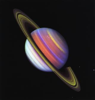 This psychedelic false-color view of Saturn from Voyager 2 reveals structure in the planet's banded clouds. Credits: NASA/JPL-Caltech