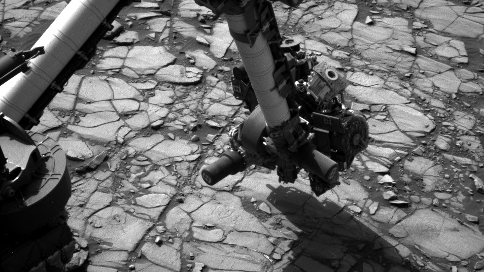 "NASA's Curiosity Mars rover began close-up investigation of a target called ""Marimba,"" on lower Mount Sharp, during the week preceding the fourth anniversary of the mission's Aug. 6, 2016, landing. Curiosity's Navigation Camera took this shot of the rover's arm over Marimba on Aug. 2, 2016. Credit: NASA/JPL-Caltech/MSSS"