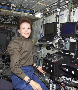 stronaut Janet Kavandi, part of the STS-104 space shuttle Atlantis crew, is seen here aboard the International Space Station in 2001. Kavandi's work on her doctoral thesis during the late 1980s helped develop the pressure-sensitive paint used by NASA today.