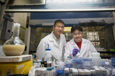 UConn engineers Professor Luyi Sun, left, and graduate student Songshan Zeng, have created new 'smart' materials that can change appearance and quickly revert to their original state, just like the squid and jellyfish that inspired them. Credit: Sean Flynn/UConn