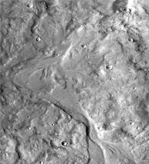 Streamlined forms in this Martian valley resulted from the outflow of a lake hundreds of millions years more recently than an era of Martian lakes previously confirmed. Image credit: NASA/JPL-Caltech/MSSS