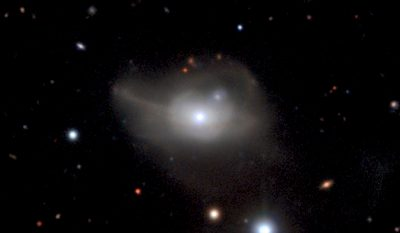 This image from the MUSE instrument on ESO's Very Large Telescope shows the active galaxy Markarian 1018, which has a supermassive black hole at its core. The faint loops of light around the galaxy are a result of its interaction and merger with another galaxy in the recent past. Image by ESO/CARS survey