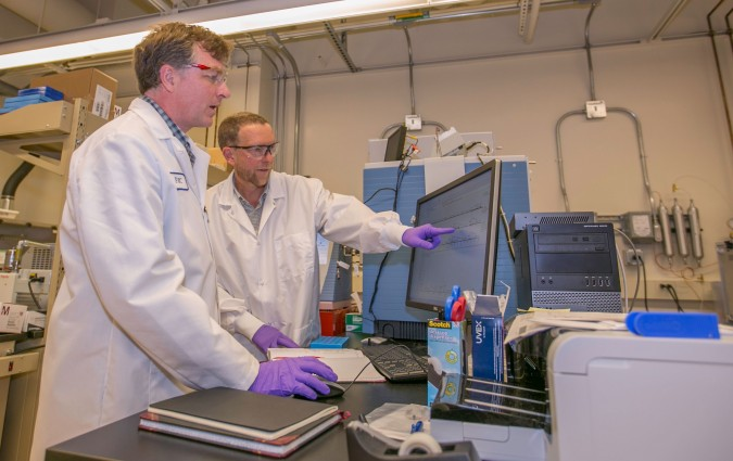 Glendon Parker (left) and Deon Anex, both of Lawrence Livermore National Laboratory's Forensic Science Center, analyze hair samples.
