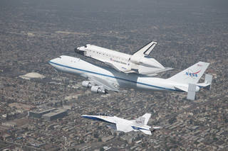 Space Shuttle Endeavour is affixed atop NASA's 747 Shuttle Carrier Aircraft as it prepares for a landing at Los Angeles International Airport to conclude a final flight on Sept. 21, 2012. Credits: NASA Photo / Jim Ross