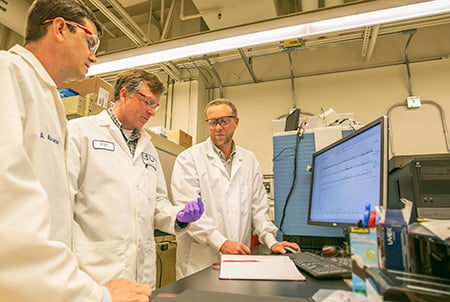 Brad Hart (left to right), director of Lawrence Livermore National Laboratory's Forensic Science Center, biochemist Glendon Parker and chemist Deon Anex analyze hair samples using protein markers from the hair.