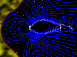An artist's rendering (not to scale) of a cross-section of the magnetosphere, with the solar wind on the left in yellow and magnetic field lines emanating from the Earth in blue. The five THEMIS probes were well-positioned to directly observe one particular magnetic field line as it oscillated back and forth roughly every six minutes. In this unstable environment, electrons in near-Earth space, depicted as white dots, stream rapidly down magnetic field lines towards Earth's poles. There, they interact with oxygen and nitrogen particles in the upper atmosphere, releasing photons and brightening a specific region of the aurora. Credits: Emmanuel Masongsong/UCLA EPSS/NASA