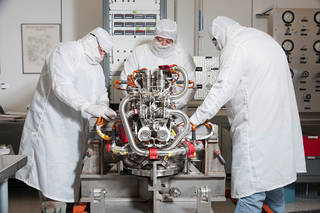 Engineers and technicians in WSTF's Technical Services Section conduct functional tests on OMS Engine 108. Credits: NASA WSTF
