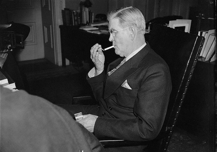 Smoking indoors was once completely normal, but nowadays is against the social norms. Image credit: Harris-Ewing collection via Wikimedia, Public Domain