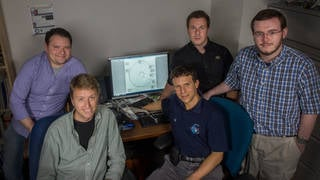 Kyle Hughes, Jeremy Knittel, Jacob Englander, David Hinckley, and Sean Napier, who are pictured from left to right, helped enhance a fully automated tool for determining orbital trajectories and spacecraft design. Credits: NASA/W. Hrybyk