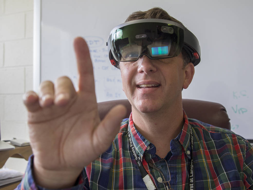 NASA Langley Research Center information technology specialist Ed McLarney demonstrates working in virtual reality with a Microsoft Hololens headset. Credits: NASA/David C. Bowman