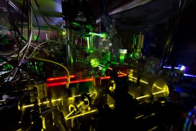 One of NIST's ytterbium lattice atomic clocks. NIST physicists combined two of these experimental clocks to make the world's most stable single atomic clock. The image is a stacked composite of about 10 photos in which an index card was positioned in front of the lasers to reveal the laser beam paths. Image credit: N. Phillips/NIST