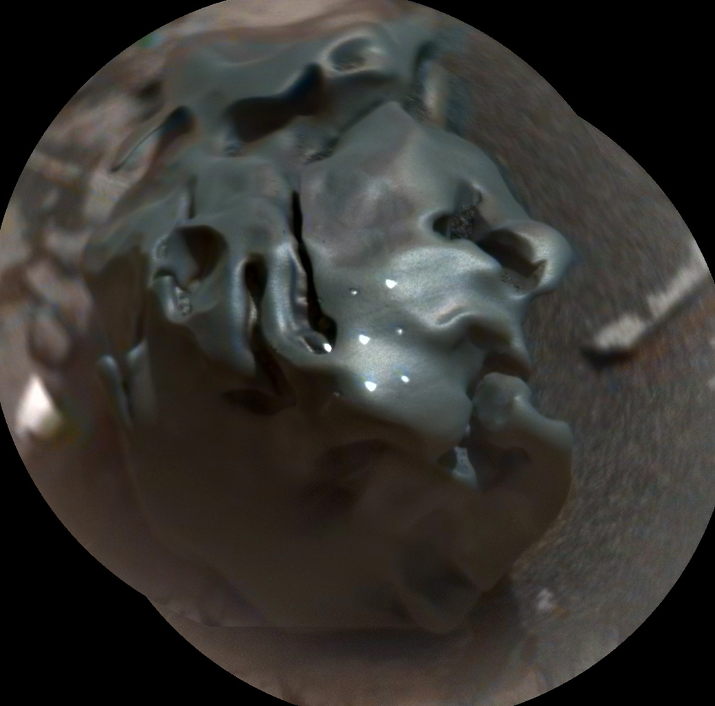The dark, golf-ball-size object in this composite, colorized view from the ChemCam instrument on NASA's Curiosity Mars rover is a nickel-iron meteorite, as confirmed by analysis using laser pulses from ChemCam on Oct. 30, 2016. The grid of bright spots on the rock resulted from the laser pulses. Credit: NASA/JPL-Caltech/LANL/CNES/IRAP/LPGNantes/CNRS/IAS/MSSS