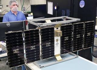 One of the eight microsatellites in the CYGNSS constellation under construction. The mission is set to launch in December to collect data to improve hurricane intensity forecasts. Credits: University of Michigan