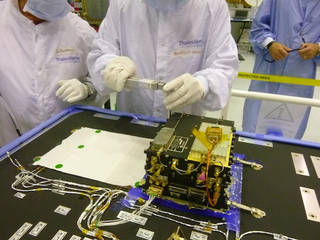 The European Space Agency's ExoMars Trace Gas Orbiter, launched on March 14, 2016, carries two Electra UHF relay radios provided by NASA. This image shows a step in installation and testing of one of those radios, inside a clean room at Thales Alenia Space, in Cannes, France, in June 2014. Credits: NASA/JPL-Caltech/ESA/TAS