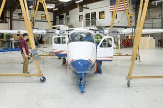 The Tecnam P2006T undergoes wing integration at Scaled Composites in Mojave, California, where the aircraft's system will be converted to feature electric propulsion. Credits: NASA Photo / Ken Ulbrich