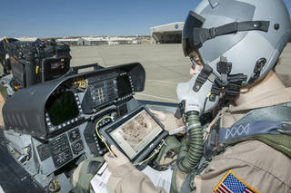 Flight Test Engineer Jacob Schaefer inspects the Cockpit Interactive Sonic Boom Display Avionics, or CISBoomDA, from the cockpit of his F-18 at NASA's Armstrong Flight Research Center in Edwards, California. Credits: NASA Photo / Ken Ulbrich