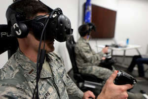 Second Lt. Kenneth Soyars takes off during a virtual reality flight simulation