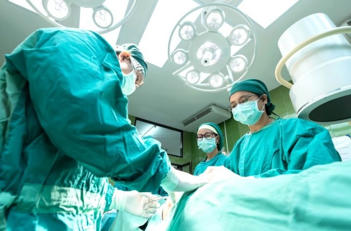 Doctors performing a surgical operation.