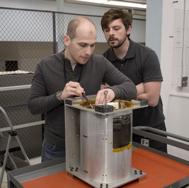 Brandon Smith, ADEPT principal investigator, and Joseph William, system engineer, in the entry systems and vehicle development lab at Ames perform final checks to the first ADEPT flight unit prior to a deployment test. Image credits: NASA Ames Research Center/Dominic Hart