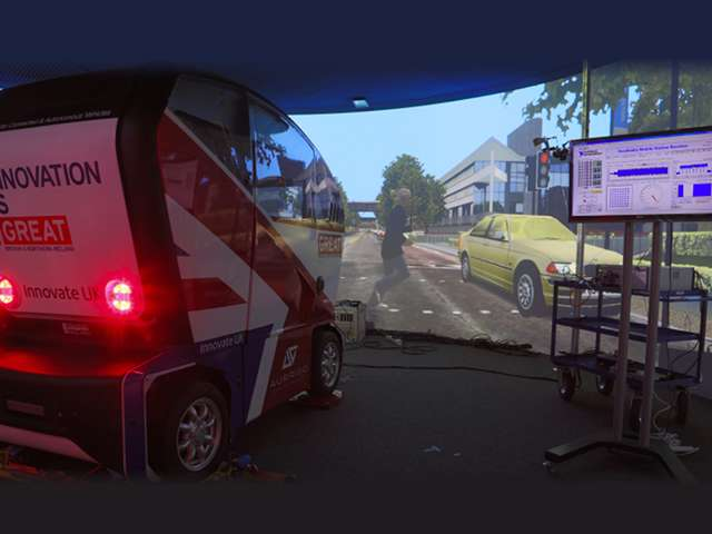 Using the NI mmWave Transceiver System, real-time data is transmitted at a rate of nearly 3 Gbps from the top of the virtual traffic light near a pedestrian crossing to an autonomous vehicle. Image credit: WMG, University of Warwick.