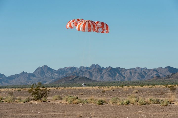 An Orion test capsule with its three main parachutes touches down in the Arizona desert Sept. 12. Image credit: NASA