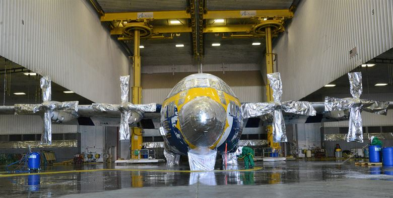 The research has implications for everything from nuts and bolts to turbine engines.  In the image, Fat Albert, the Blue Angels' C-130 cargo plane used for transporting crew and equipment to air shows around the country, recently underwent a chemical de-paint process here after severe corrosion was found on it. Crews stripped the aircraft of all paint, using a stripping agent to remove one layer at a time. Next, Fat Albert will fly to Hill Air Force Base, Utah, for full programmed depot maintenance and paint. (U.S. Air Force photo by Kelly White, Public Domain)
