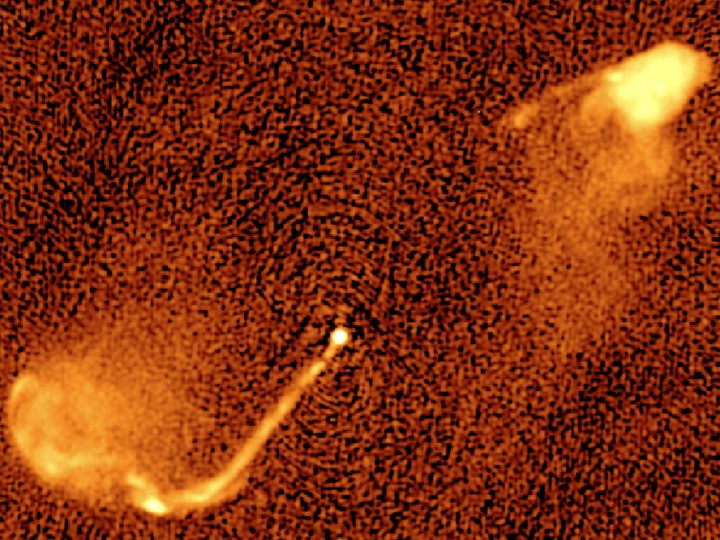 5 GHz radio map of 3C 334. The jet emanates from the nucleus of a galaxy (its stars are not visible at radio frequencies) about 10 billion light years from our own. The peculiar structure of the jets signifies a periodic change of the direction of the jet (precession), an effect that is predicted for jets from black hole pairs. Credit: M. Krause / University of Hertfordshire