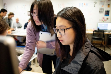 Jenny Tai (left), a lab technician, assists first-year School of Pharmacy student Monica Lomanto with her 3-D printing project. At UCSF, students are learning how to turn scans of body parts into 3D prints. Photo by Susan Merrell / UCSF